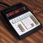 Programming console with buttons and alphanumeric indicators